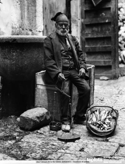 Fish vendor in traditional dress,