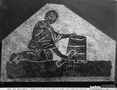 A man measuring grain in