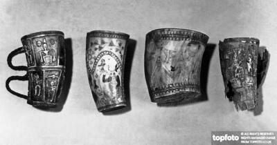 Four horn cups with engraved