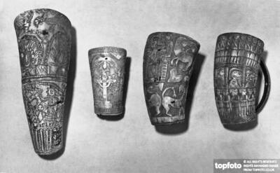 Horn cups with engraved decorations;