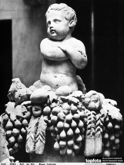 Putto with crossed arms on
