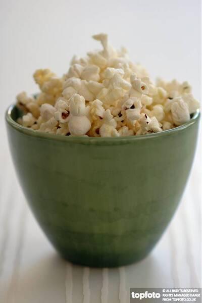Popcorn in green pottery bowl