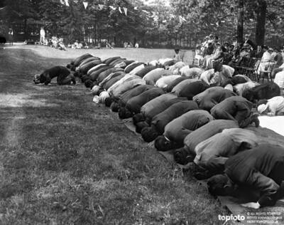 Worshippers praying at the Mosque