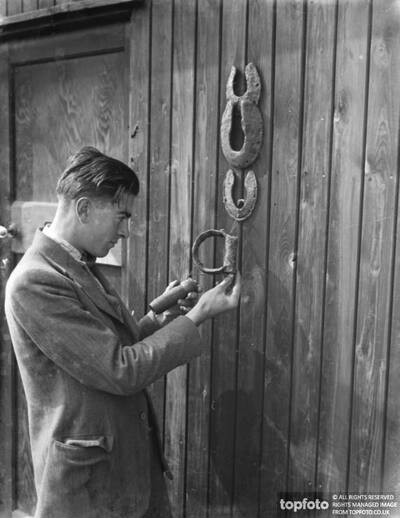 Mr Greenfield examines horseshoes and