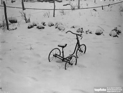 A tricycle in the snow