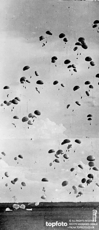 Parachutists fill the sky._x000D_ Mass parachute