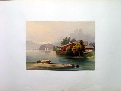 Case in riva ad un lago tra i monti