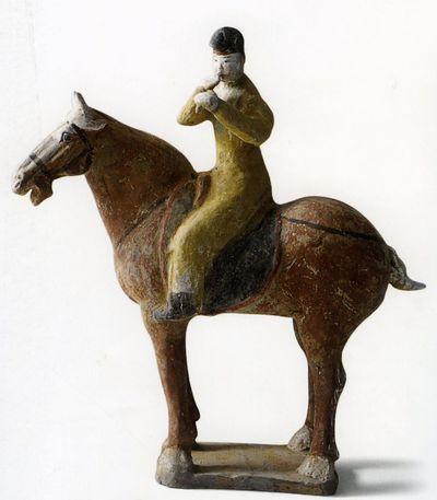 Suonatore di 'bili' a cavallo