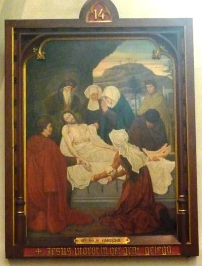 Statie 14: Jezus wordt in het graf gelegd.