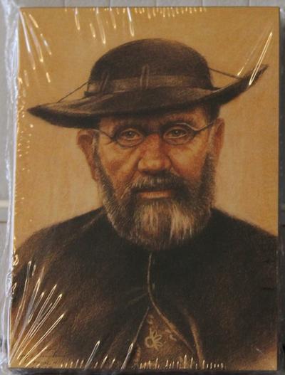 Een houten icoontje van pater Damiaan