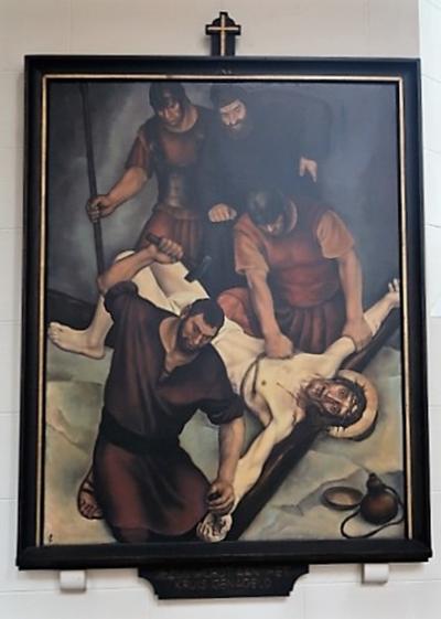 Kruiswegstatie XI: Jezus wordt aan het kruis genageld