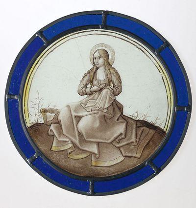 Vrouwelijke heilige met naaiwerk en schaar