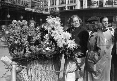 Marchande de fleurs- bloemenverkoopster