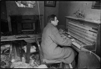 Tom Harrisson plays piano