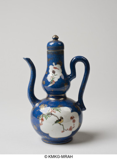 Lidded ewer, decorated in powderblue with gilded flowers and reserved pannels with flowers and birds in ironred, yellow, green and aubergine