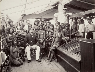 Group portrait with Mentawai people visiting the government steamer 'Zwaluw'