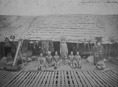 Group portrait Dayak people in front of a house
