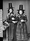 [Two women in national dress drinking tea (Jones)]