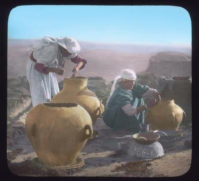 Peasant women making 'zirs'. Large earthenware jars