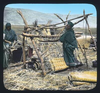 Bedouin woman weaving papyrus mats