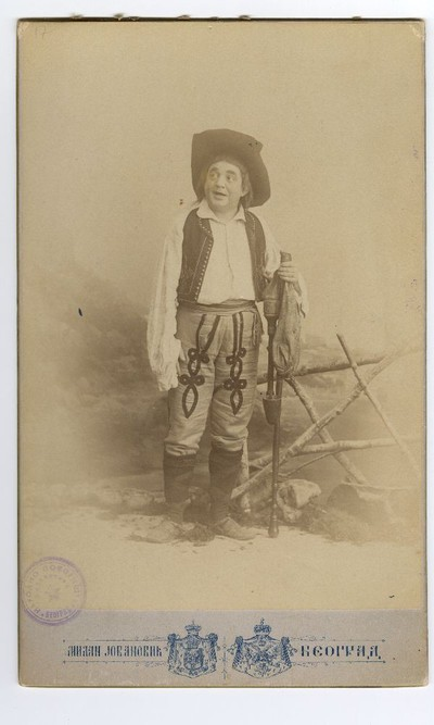 Studio portrait of Pera Dobrinović in character from the play 'Riđokosa'