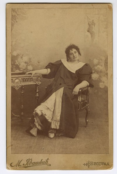 Studio portrait of Vela Nigrinova posing as 'Madame Sans-Géne'