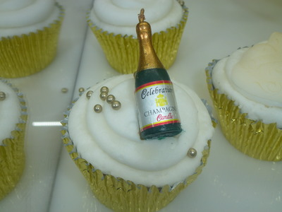 cupcake with champagne bottle  candle