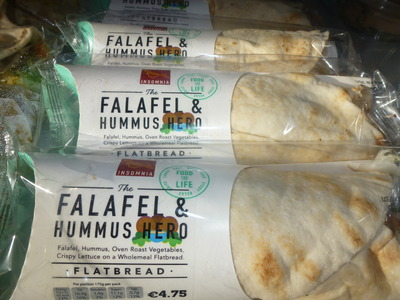takeaway selection of falafel and hummus wrap