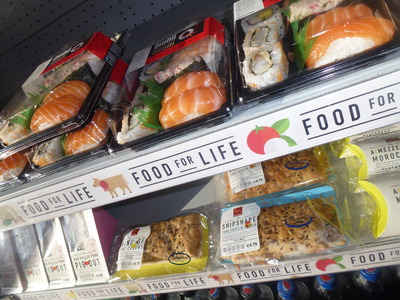 takeaway selection of sushi and sandwich display
