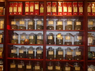 tea blends in glass jars and tins
