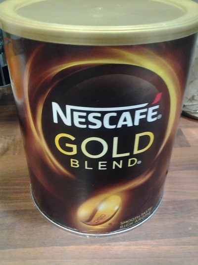 tin of ground coffee