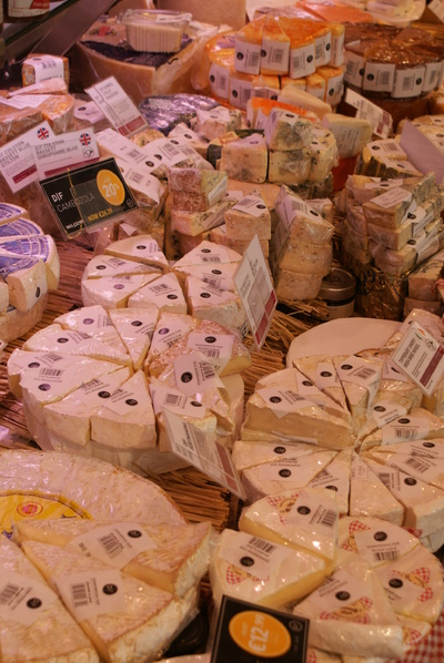 wedges of assorted cheeses