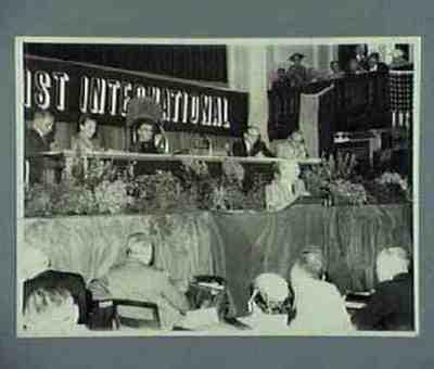 Attlee speaks Fltr Braunthal, Summerskild, Phillips, Mollet and Ollenhauer