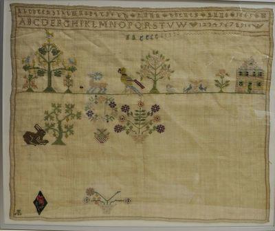 Borduurwerk door Anna Boene. Voorstellende 3bomen, 1 huis, 4 bloemstukken, 4 dieren