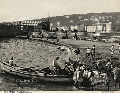 Fishermen at work on a pier in Naples