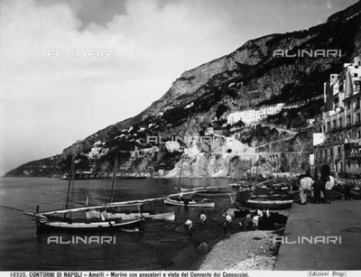 Marina with fishermen and the Capuchins' Convent in the background in Amalfi.
