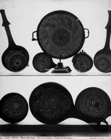 Bronze drainers decorated with geometrical motifs found in Pompeii and Herculaneum, now kept at the National Archaeological Museum in Naples.