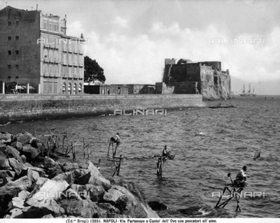 Stretch of Via Partenope in Naples and Castel dellOvo. Some fishermen are in the foreground.