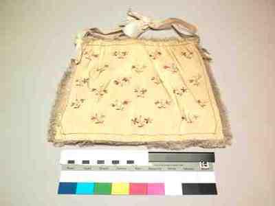 Tas van gele ribszijde geborduurd met strooibloempjes in 3 tinten roze