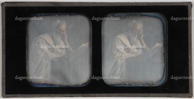 genre tafereel; een oude man met lange grijze haren en baard, in een gestreept gewaad; gezeten aan een lezenaar voor een open geslagen boek voor een stapel boeken