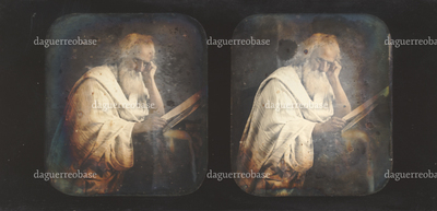Academic study, old man with a long white beard, staring beside a large book