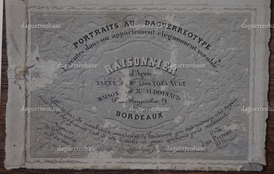A detached photographer's label from a daguerreotype.