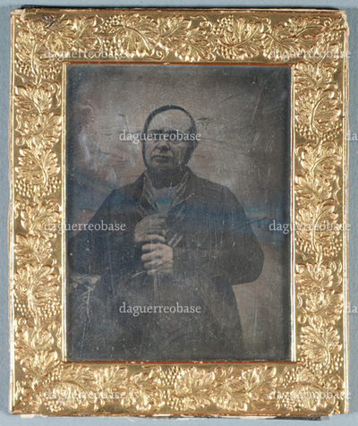 Portrait of Carl Grönberg with a walking stick and  glasses.