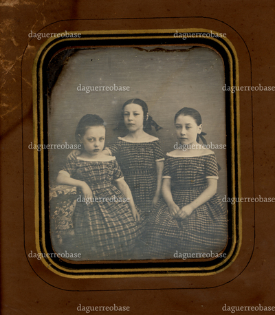 Group portrait of three girls, sisters