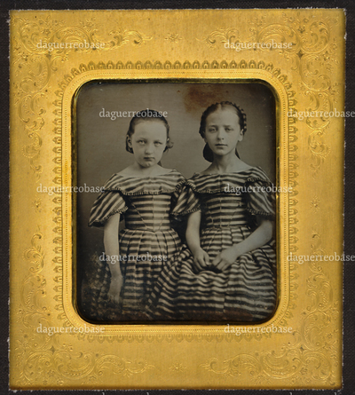 Portrait of two children in a similar dress, probably sisters