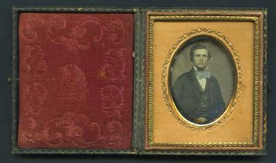Portrait of Edgar with blue tie