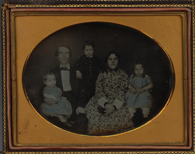 Family group portrait of a man, woman and three children