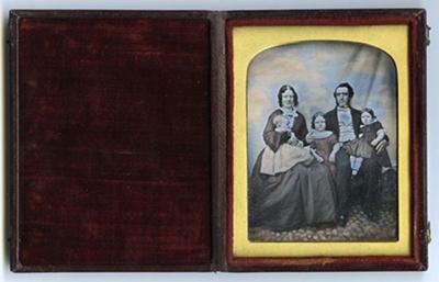 Family portrait with three children