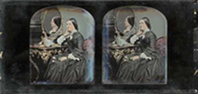 Portrait of woman before a dresser with mirror