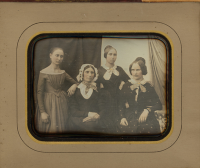 Family group portrait of four women, different in age